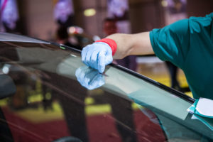 a car receiving windshield repair services from a skilled professional