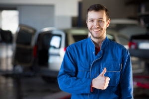 A smiling young man giving a thumbs up after visiting the Dent Removal Training Institute at C & D Dent Guys